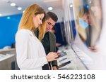 two people are choosing digital ... | Shutterstock . vector #546223108