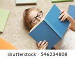 cute little girl reading book... | Shutterstock . vector #546234808