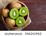 Kiwi Fruit On Wooden Background ...