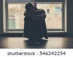 Depressed Man Sitting On Floor...