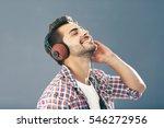 emotional man with headphones... | Shutterstock . vector #546272956