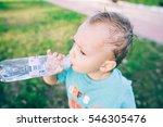 little boy drink water  outdoor | Shutterstock . vector #546305476