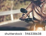 biker in helmet and leather... | Shutterstock . vector #546338638