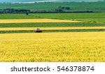 farm tractor handles earth on... | Shutterstock . vector #546378874