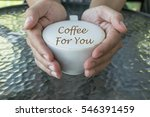 man holding hot cup of coffee... | Shutterstock . vector #546391459