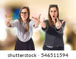 twin sisters making horn... | Shutterstock . vector #546511594