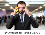 young businessman with headache ... | Shutterstock . vector #546525718