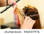 Small photo of Female hairdresser hold in hand between fingers lock of blonde hair, comb and scissors closeup. Keratin restoration, latest trend, fresh idea, haircut picking, shorten tips, instrument store concept