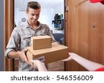 young man receiving package... | Shutterstock . vector #546556009