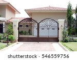 iron front gate of a luxury home | Shutterstock . vector #546559756