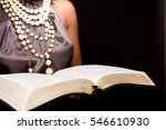 well dressed woman reading the... | Shutterstock . vector #546610930