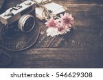 vintage camera with bouquet of...   Shutterstock . vector #546629308