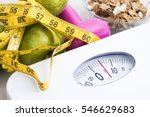 Stock photo scale with cereals fruit weight and tape measure and concept of diet and healthy lifestyle 546629683