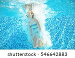 Child Swims In Pool Underwater  ...
