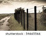 A Grungy Barbed Wire Fence Wit...