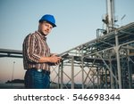 man using tablet at natural gas ... | Shutterstock . vector #546698344