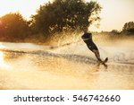 Man Wakeboarding On A Lake Wit...