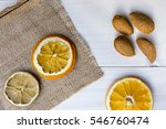 dried oranges with almonds on... | Shutterstock . vector #546760474