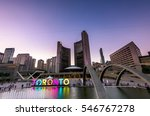 Stock photo toronto city hall and toronto sign in downtown at twilight in toronto ontario canada 546767278