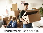 young couple moving in to house  | Shutterstock . vector #546771748