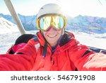Happy Skier Taking Selfie Phot...