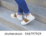 stylish casual shoes. legs of a ... | Shutterstock . vector #546797929