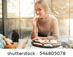 portrait of young woman eating... | Shutterstock . vector #546805078