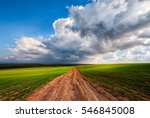 rural road landscape sky clouds