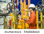 Small photo of Offshore oil and gas maintenance activity, production operator logging data in night shift operation to observe abnormal reading value and condition of gas treatment process.