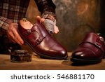 man shining shoes with a rag | Shutterstock . vector #546881170