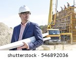 confident architect holding... | Shutterstock . vector #546892036