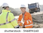 happy engineer discussing with... | Shutterstock . vector #546894160