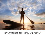 Paddle Standing  Silhouette Of...