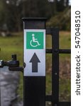 Small photo of Wheelchair Accessibility Sign on Gate