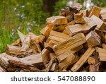 firewood on green grass...