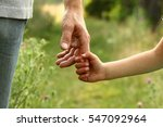 the parent holds the hand of a... | Shutterstock . vector #547092964