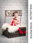 Small photo of Little adorable kid covered red lipstick kisses