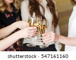 hands holding the glasses of... | Shutterstock . vector #547161160