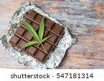 marijuana leaves on top of dark ... | Shutterstock . vector #547181314