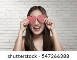 smiling asian woman covering... | Shutterstock . vector #547266388