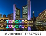 Small photo of TORONTO, CANADA - NOVEMBER 11, 2016: Nathan Phillips Square lit up as night comes on in Toronto, Canada.