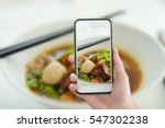 hand holding smartphone with... | Shutterstock . vector #547302238