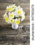 white daffodils at china vase... | Shutterstock . vector #547302673