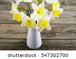 white daffodils at china vase... | Shutterstock . vector #547302700