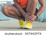 urban jogger having injury  ... | Shutterstock . vector #547442974