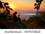 young girl sitting on the rock... | Shutterstock . vector #547473820