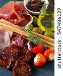 assorted antipasti | Shutterstock . vector #547486129