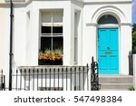 white wall with blue door and... | Shutterstock . vector #547498384