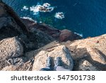 standing on the edge of a cliff   Shutterstock . vector #547501738