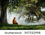 Buddhist Monk Meditating Under...